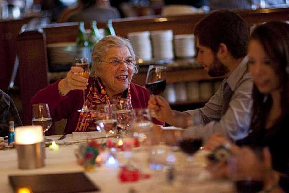 Marcia Ben-Ora toasts with her grandson, Carmi Schulman as they enjoy Thanksgiving dinner with their family at One Market Restaurant on November 25, 2010 in San Francisco, Calif. Photograph by David Paul Morris/Special to the ChronicleMarcia Ben-Ora toasts with her grandson, Carmi Schulman as they enjoy Thanksgiving dinner with their family at One Market Restaurant on November 25, 2010 in San Francisco, Calif. Photograph by David Paul Morris/Special to the Chronicle Photo: David Paul Morris, Special To The Chronicle