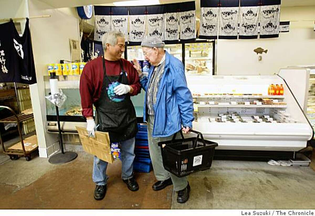 Lee Nakamura (left,) who owns Tokyo Fish Market and Gift Shop with Larry Fujita, shares a laugh with customer Leonard Marks (right) of Piedmont at Tokyo Fish Market in Berkeley, Calif. on Wednesday April 8, 2009.