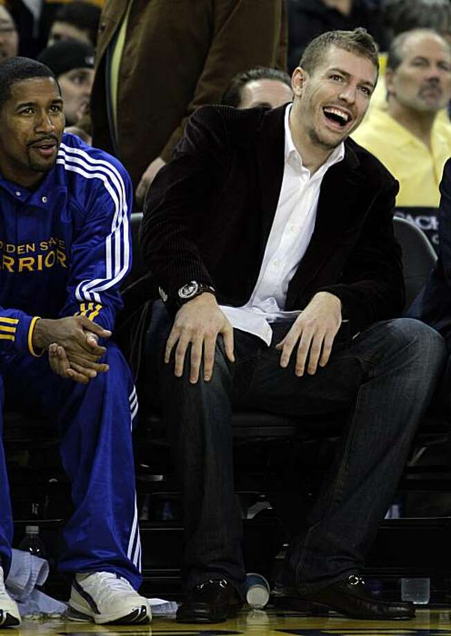 Golden State Warriors' David Lee, right, laughs on the bench during the first half of an NBA basketball game against his former team, the New York Knicks, Friday, Nov. 19, 2010, in Oakland, Calif. Photo: Ben Margot, AP