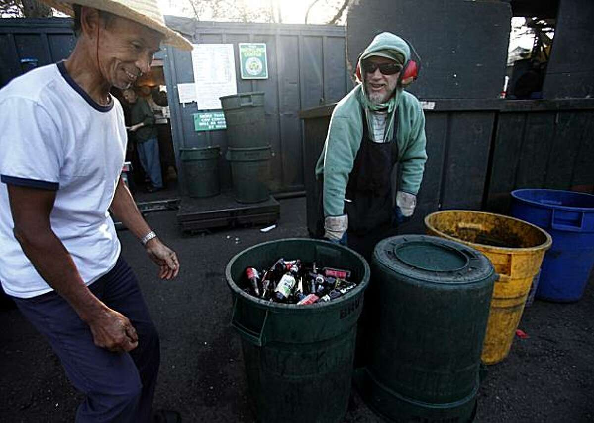 Tan Chang (lft), who says he redeems cans and bottles so that he can eat, recycles a pile of cans and bottles at HANC recycling center in Golden Gate Park, with the help of veteran HANC employee, Brian McMahon (rt), on Thursday Nov. 11, 2010 in San Francisco, Calif. The recycling center that was started, at a different location, in 1974 is now facing potential shutdown by the city unless they can find a different location in which to operate. People who use the facility daily say they can't live without it while certain neighborhood groups says its a magnet for the homeless.