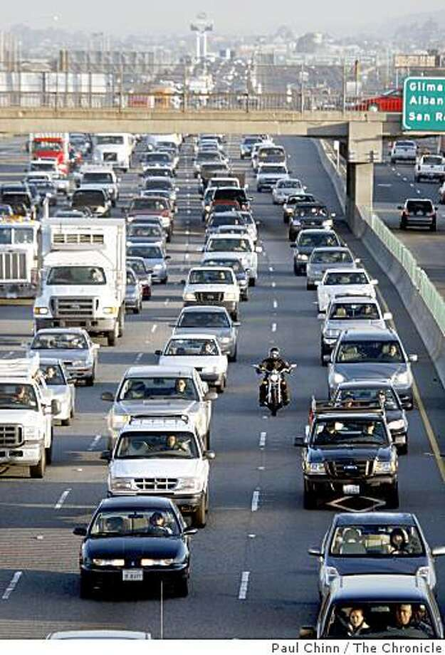 All roads leading to the Bay Bridge, including westbound Interstate 80 in Berkeley, slowed to a near standstill after an accident involving a big rig and several cars blocked two lanes of traffic near the Fremont Street exit before dawn in San Francisco, Calif., on Tuesday, March 18, 2008. It took officials over an hour to clear the lanes which backed up traffic for several miles in every direction in the East Bay.Photo by Paul Chinn / San Francisco Chronicle Photo: Paul Chinn, The Chronicle