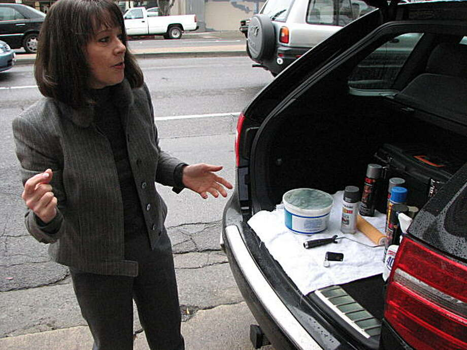 Paula Mulhall drives a Porsche, dresses in designer clothes and carries a paint roller to eradicate graffiti Photo: C.W. Nevius, San Francisco Chronicle