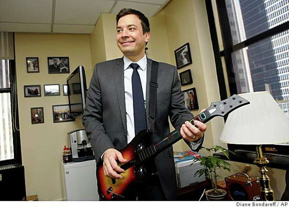 "Jimmy Fallon, who is replacing fellow Saturday Night Live alum Conan O'Brien as the host of NBC's ""Late Night"" talk show, now known as ""Late Night with Jimmy Fallon,"" poses for a photograph in his Rockefeller Center office, Monday, Feb. 23, 2009, in New York. Photo: Diane Bondareff, AP"