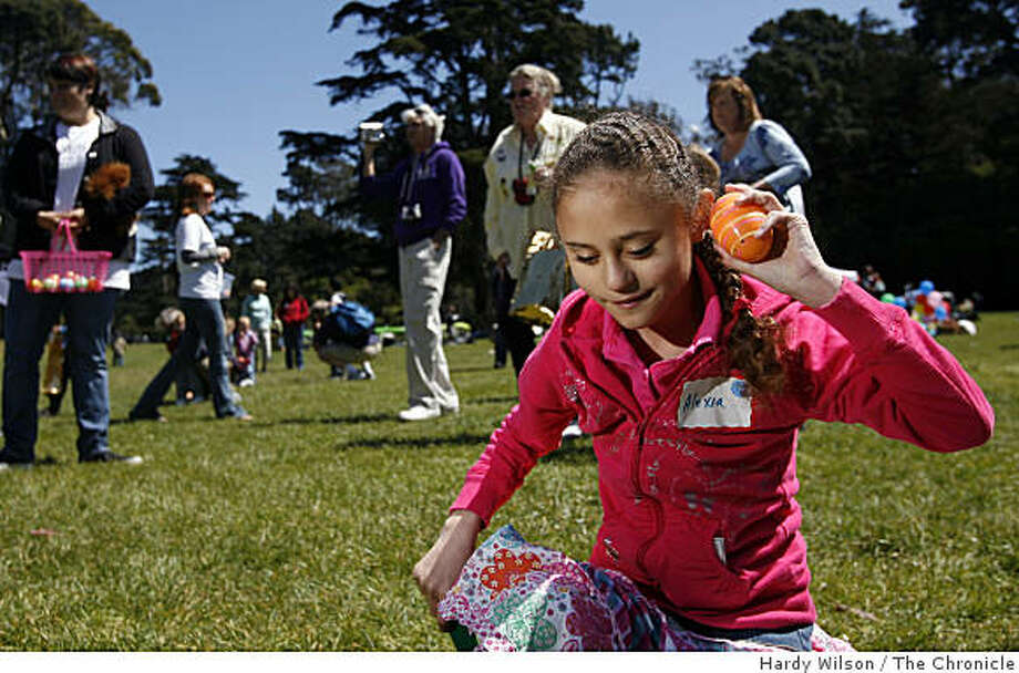 Alexia Arriola, 9, of San Jose, listens to a beeping Easter egg during the Beeper Egg Hunt hosted by the Blind Babies Foundation in Golden Gate Park in San Francisco, Calif., on Saturday, April 11, 2009. The event was put on to help blind and visually-impaired children hunt for Easter eggs. Photo: Hardy Wilson, The Chronicle
