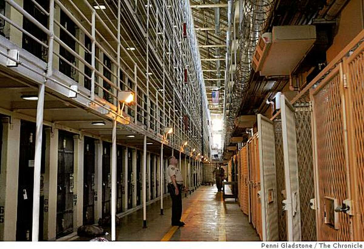 An officer patrols the east block for death row prisoners at San Quentin prison in San Quentin, Calif. on October 26, 2004. Photo by Penni Gladstone.