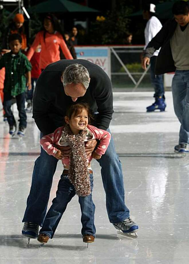 Tony Elkin and his daughter Mya skate on the Union Square ice rink in San Francisco, Calif., on Saturday, Nov. 20, 2010. Photo: Paul Chinn, The Chronicle
