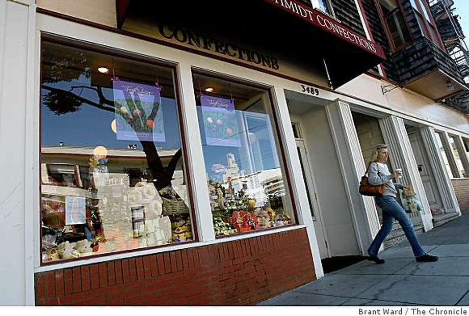 A customer leaves Joseph Schmidt Confections in a quiet tree lined block on 16th Street Thursday April 2, 2009. The Joseph Schmidt brand of confections is being discontinued by Hershey Corp. Stores including the one at 3489 16th Street in San Francisco, CA will close by June 30. Photo: Brant Ward, The Chronicle