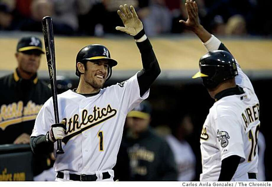 Nomar Garciaparra and Orlando Cabrera celebrate after Cabrera scored in the bottom of the second inning. The Oakland Athletics played the Boston Red Sox at McAfee Coliseum in Oakland, Calif., on Monday, April 13, 2009. Photo: Carlos Avila Gonzalez, The Chronicle