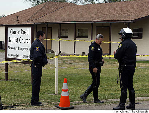 Police officers guard the entrance to the Clover Road Baptist Church in Tracy, Calif., on Tuesday, April 7, 2009. Investigators are extending their search for evidence in the murder of Sandra Cantu to the church after the eight-year-old's body was discovered in a large suitcase by farm workers draining an irrigation ditch Monday. Photo: Paul Chinn, The Chronicle