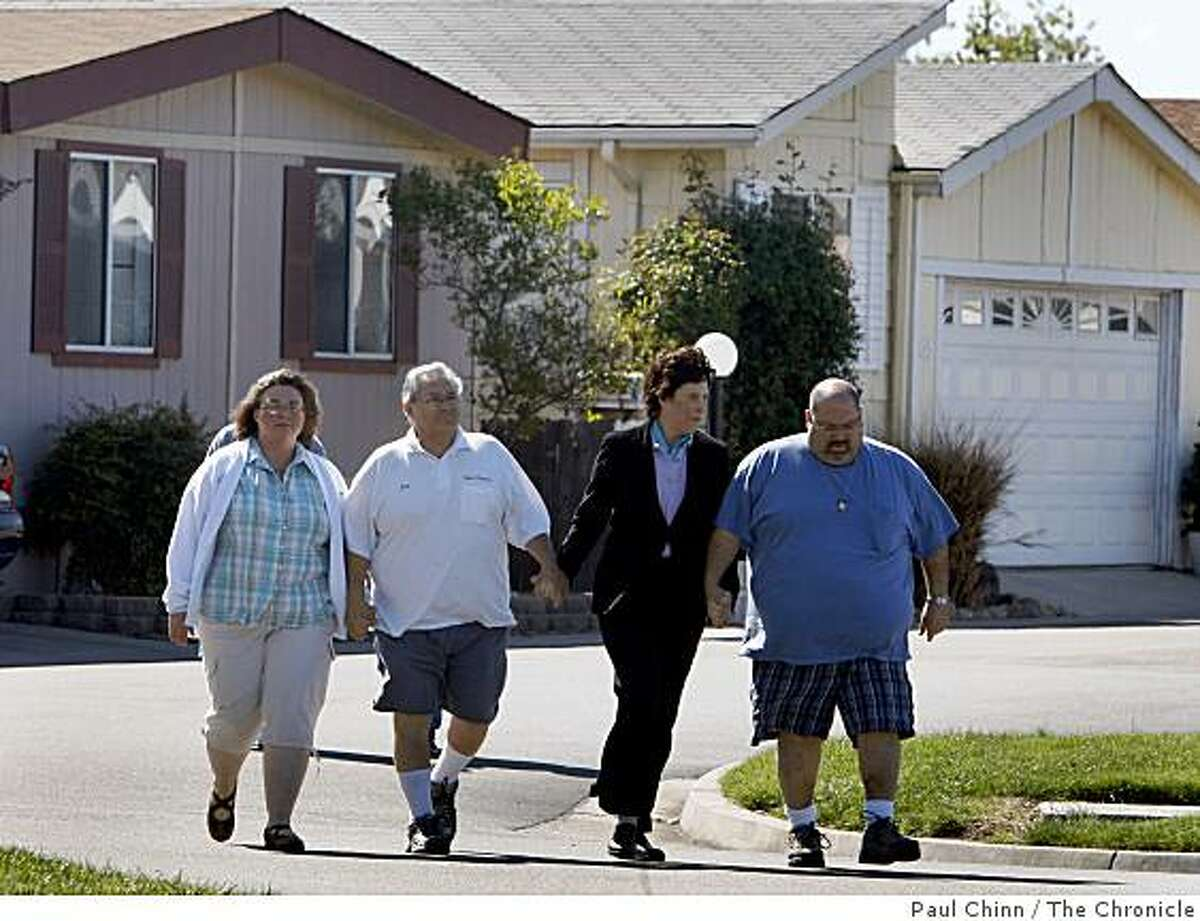 From left: Angie Chavez, Jose Chavez, Susan Levy and Joe Chavez walk though the Orchard Estates mobile home park after police announced the arrest of Melissa Huckaby for the murder of 8-year-old Sandra Cantu in Tracy, Calif., on Saturday, April 11, 2009. The Chavez's are relatives of Sandra. Levy, the mother of Chandra Levy, is helping the family with the ordeal.
