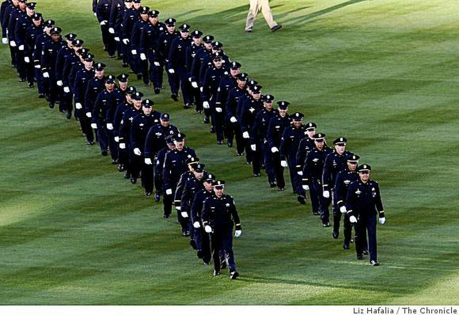 Over 50 Oakland Police officers were part of an Oakland Athletics pre-game ceremony at the Oakland-Alameda County Coliseum in Oakland, Calif., on Friday April 10, 2009. Photo: Liz Hafalia, The Chronicle