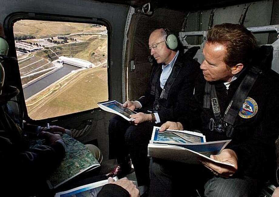 Interior Secretary Ken Salazar, left, and California Gov. Arnold Schwarzenegger look over a pumping plant in Sacramento Delta region in California during a helicopter tour, Wednesday, April 15, 2009.  Salazar is expected to promise federal funds to help with California's water problems. (AP Photo/Robert Durell, Pool) Photo: Robert Durell, AP