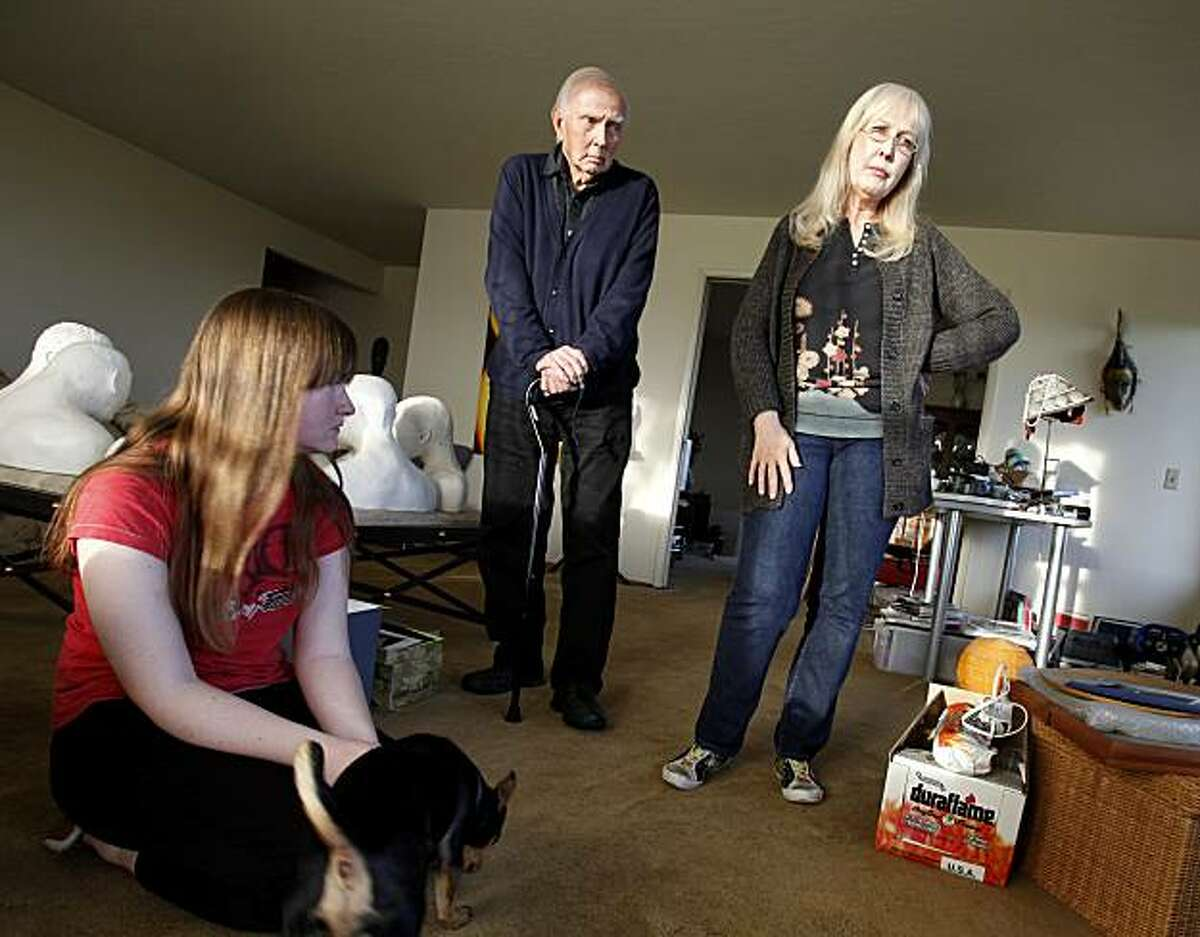 Susan Gerke (right), her father Robert Gorman (center), daughter Susan (left) and family dog Hugo in the living room of their home Tuesday November 23, 2010. Susan and Robert Gerke thought they were doing everything their bank, CitiMortgage, wanted them to do to get a loan modification on their San Rafael, Calif. home. Now the bank is set to foreclose on the family which includes their daughter Sarah, and father Robert.
