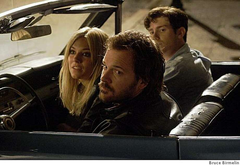 "Peter Sarsgaard, Sienna Miller, and Jon Foster in ""The Mysteries of Pittsburgh."" Photo: Bruce Birmelin"