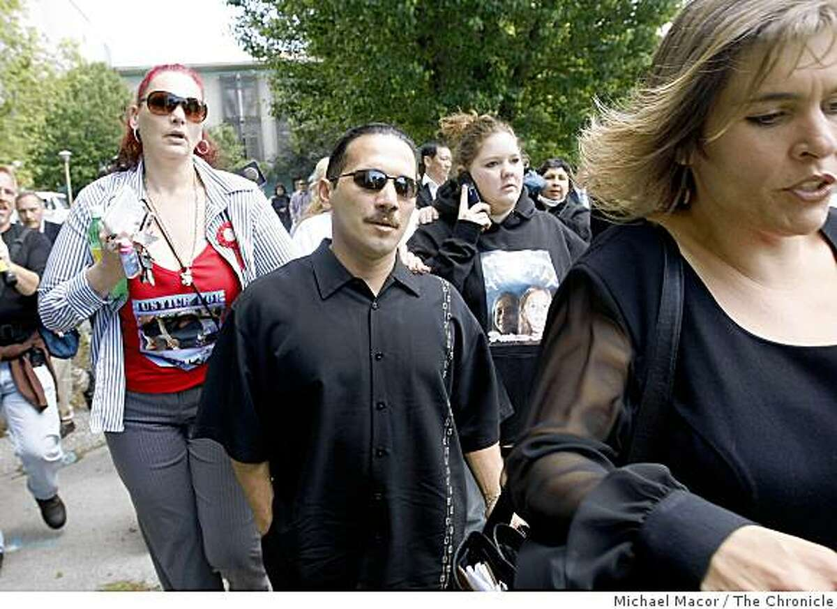 Daniel Cantu, (center), the father of 8-year-old, Sandra Cantu, leaves the San Joaquin County Courthouse following the arraignment of Melissa Huckaby, in Stockton, Calif., on Tuesday April 14, 2009, for the murder of his daughter.