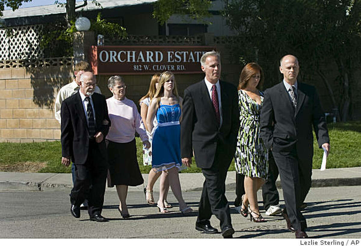 Family members of Melissa Huckaby cross the street in front of the Orchard Estates Mobile Home Park to meet with reporters in Tracy, Calif. on Sunday, April 12, 2009. Melissa Huckaby was arrested late Friday on charges of homicide and kidnapping in the case of Sandra Cantu. (AP Photo/The Sacramento Bee, Lezlie Sterling) **MAGS OUT; TV OUT; NO SALES; MANDATORY CREDIT**