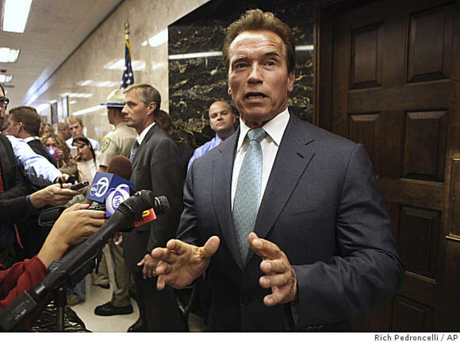 Gov. Arnold Schwarzenegger discusses the state budget deficit outside his Capitol office in Sacramento, Calif., Tuesday, June 9, 2009. (AP Photo/Rich Pedroncelli) Photo: Rich Pedroncelli, AP