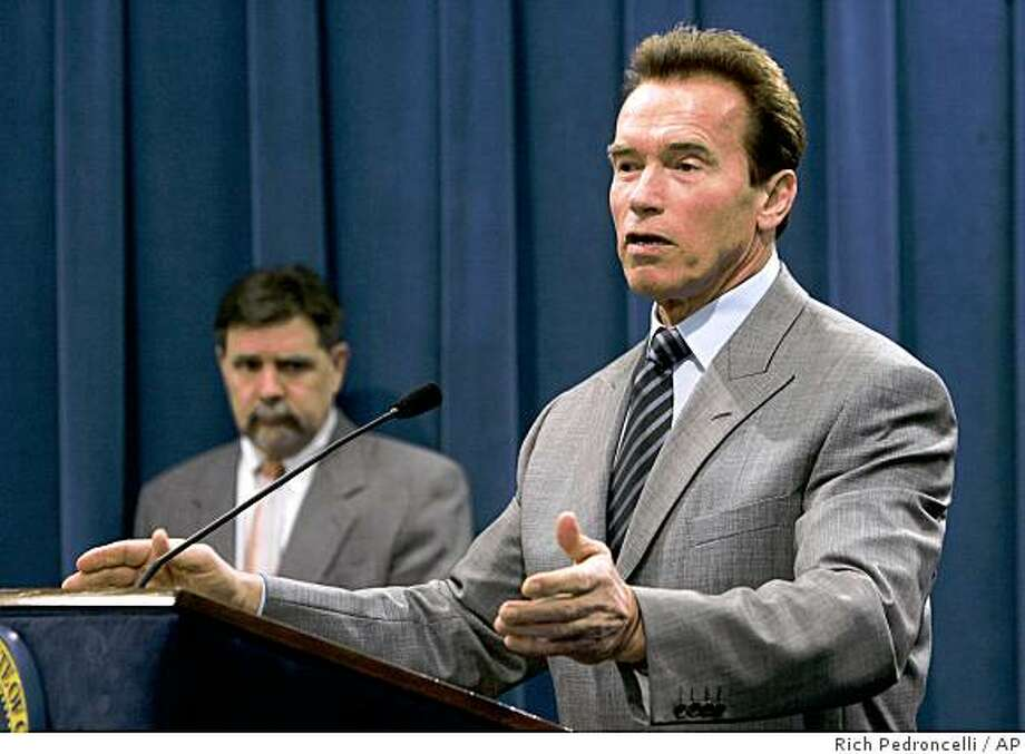 ** CORRETCS DAY TO TUESDAY NOT MONDAY  ** Gov. Arnold Schwarzenegger, flanked by Finance Director Mike Genest, left,  tells reporters that California should be making more money off it's lottery by leasing to the highest bidder, during a Capitol news conference in Sacramento, Calif., Tuesday,  Feb. 19, 2008.  Confidential Wall Street analyses show that would require that a vast expansion of gambling in the state. (AP Photo/Rich Pedroncelli) Photo: Rich Pedroncelli, AP