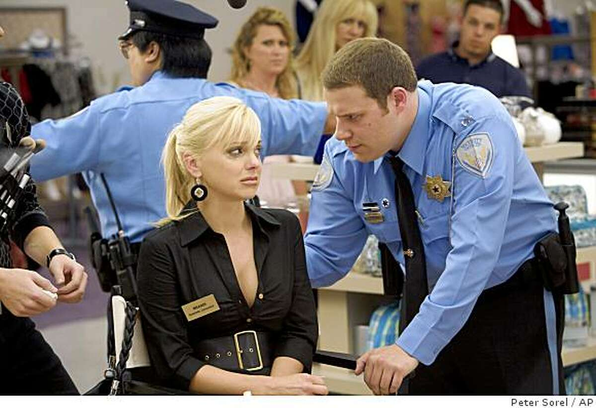 """In this image released by Warner Bros., Anna Faris, left, and Seth Rogen are shown in a scene from """"Observe and Report."""""""