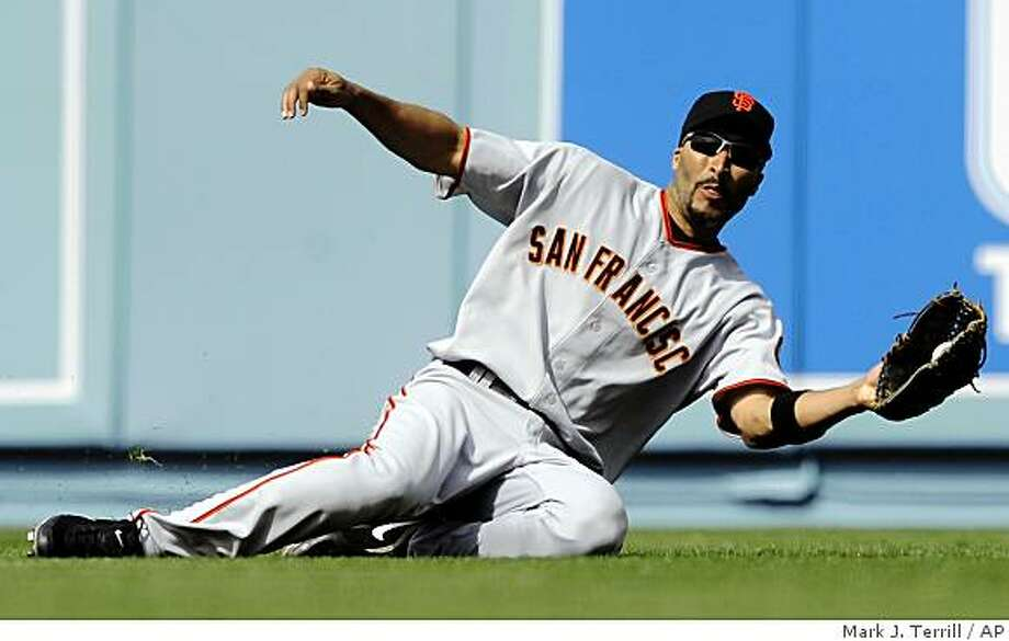 San Francisco Giants right fielder Randy Winn makes a sliding catch on a ball hit by Los Angeles Dodgers' Russell Martin during the sixth inning of their game, Monday, April 13, 2009, in Los Angeles. Photo: Mark J. Terrill, AP