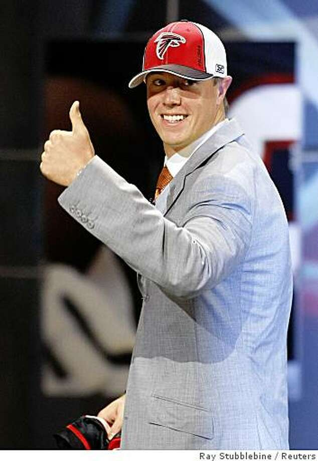 Matt Ryan, Boston College quarterback, the third pick selected by the Atlanta Falcons, gives the thumbs up to fans during the 2008 NFL Draft in New York April 26, 2008.  REUTERS/Ray Stubblebine (UNITED STATES) Photo: Ray Stubblebine, Reuters