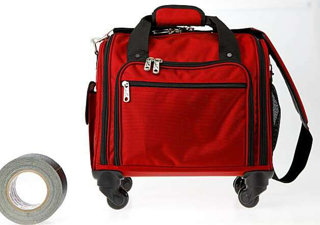The Plane Case (with spinner wheels) by TravelSmith is a rolling overnight bag that can fit under most airline seats. While not built specifically to carry tech gear, it can hold a laptop or iPad (if separately padded) and plenty of accessories and chargers. It comes with a separate tote that can be folded and stowed in the front pocket. Photo: Russell Yip, The Chronicle