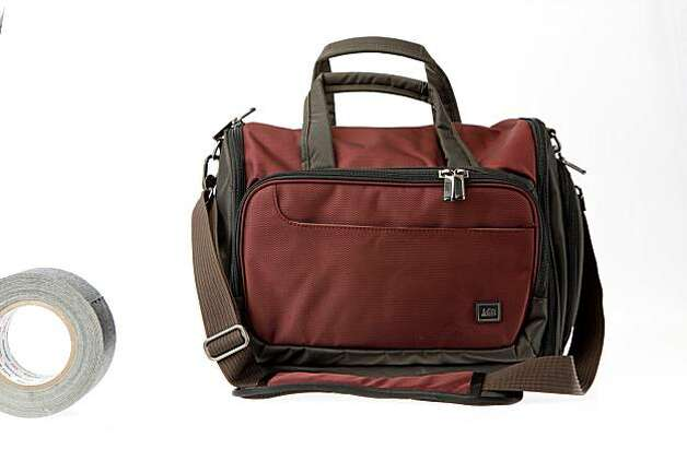 The Inside Passage Accessory Bag from REI is a briefcase-size bag with roomy central space and modest side space for a few essentials. It can fit a 14-inch laptop, but seems better suited for those carrying an iPad or other tablet or eBook. Photo: Russell Yip, The Chronicle