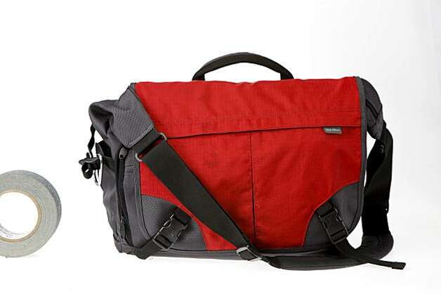 The Rick Steves Autobahn Messenger Bag features a padded, side-access slot for a laptop, but the bag expands to hold plenty of other necessities. Even packed full, it will fit under most airline seats. Photo: Russell Yip, The Chronicle