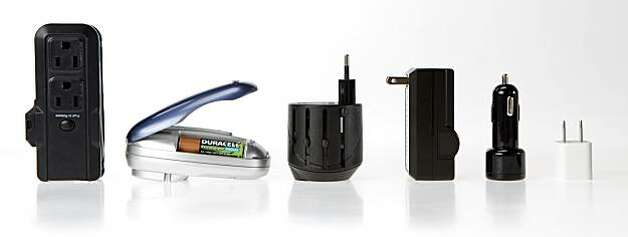 From left to right: A generic brand three-plug power bar with breaker reset; a charger for Duracell's rechargeable AA batteries; Kensington International Travel Plug Adapter; a generic charger for Panasonic camera batteries; the Griffin 2.1 amp Car Charger for iPod, iPhone and iPad; and the 5v USB charger from Apple for iPhone and iPod. Photo: Russell Yip, The Chronicle