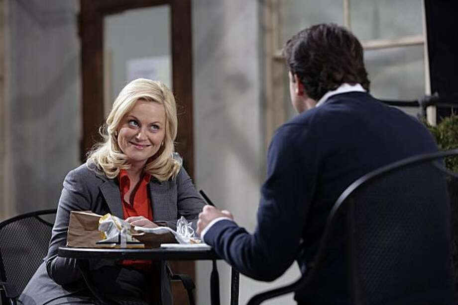 "PARKS AND RECREATION -- ""Pilot"" -- Pictured: Amy Poehler as Leslie Knope, Paul Schneider as Mark Brendanawicz Photo: Mitch Haddad, NBC Universal, Inc."