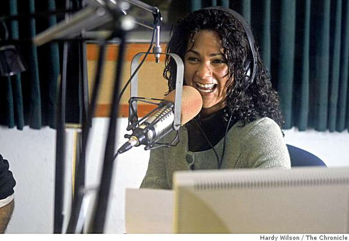 Aimee Allison, a host on KPFA's morning show, laughs while taking a call on air in at their Berkeley, Calif., studio on Thursday, April 9, 2009. KPFA will be celebrating 60 years on April 15th.