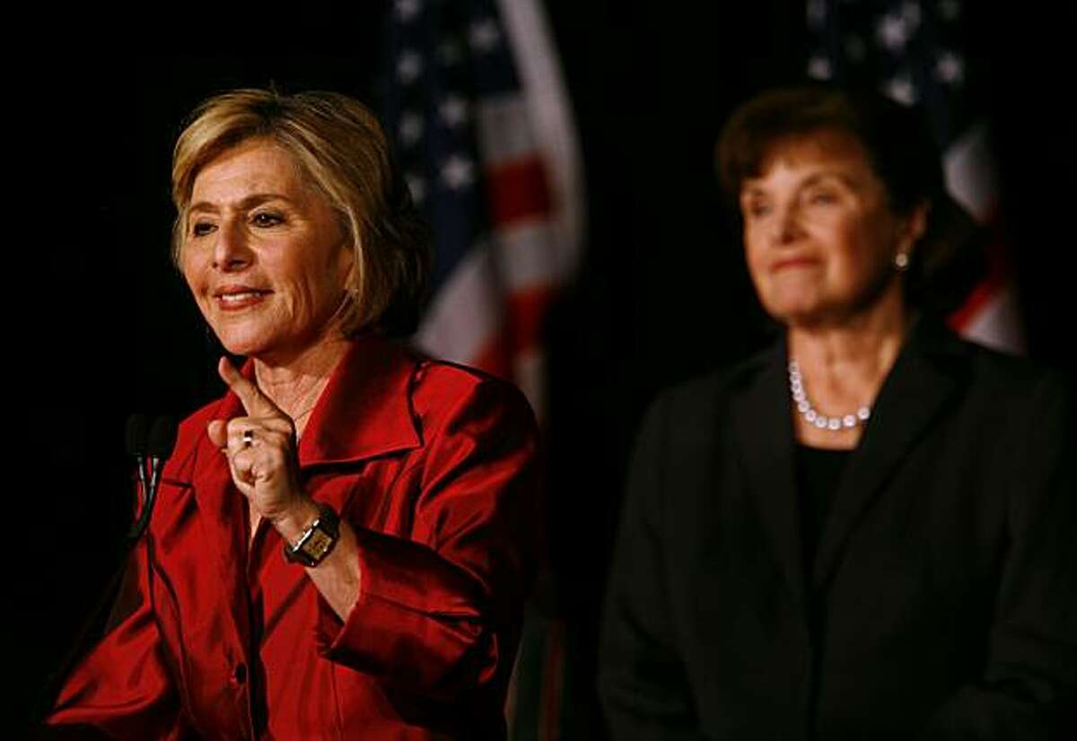 LOS ANGELES, CA - NOVEMBER 2: (L-R) U.S. Sen. Barbara Boxer (D-CA) speaks during a post election party as U.S. Sen. Dianne Feinstein (D-CA) watches November 2, 2010 in Hollywood, California. Boxer (D-CA) was declared the winner against Republican senatorial candidate and former head of Hewlett-Packard Carly Fiorina.