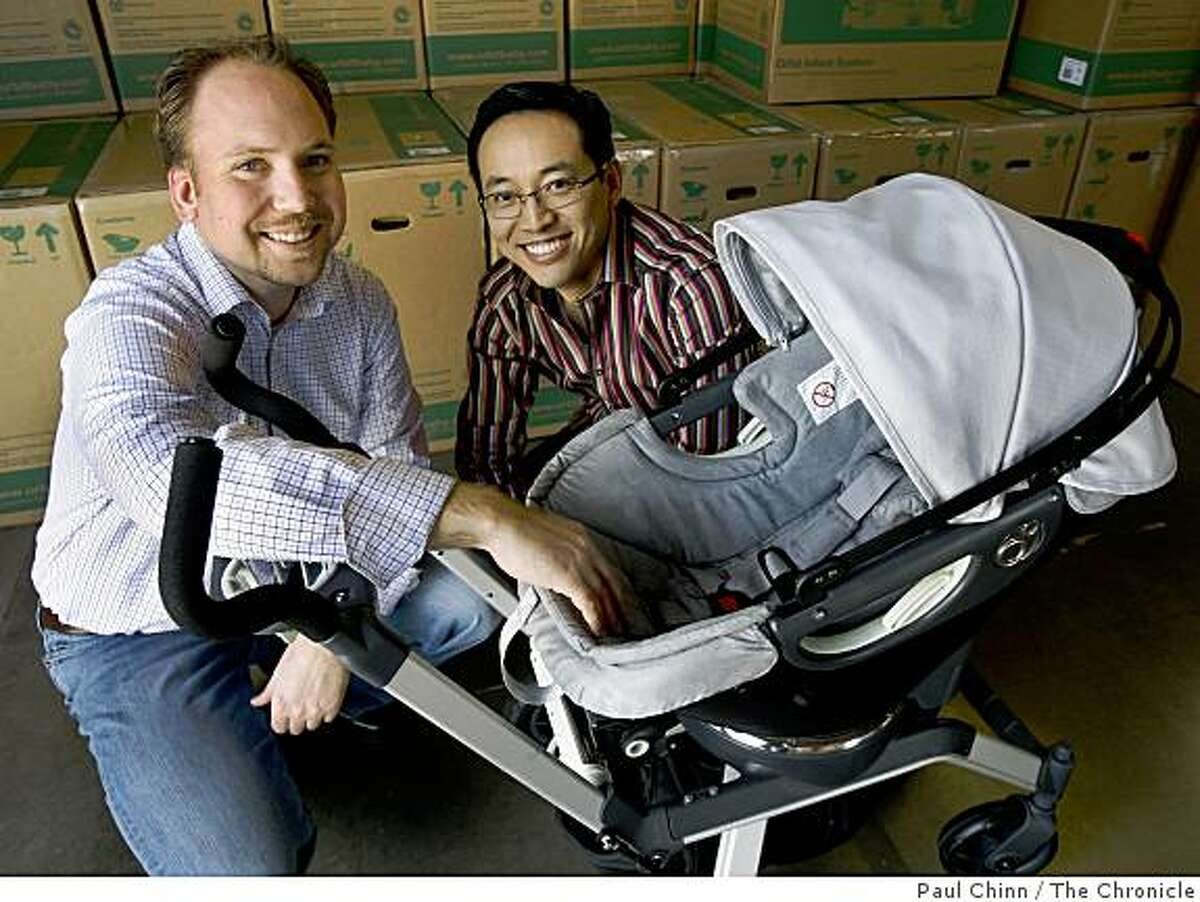 Bryan White (left), and Joseph Hei, display their popular Orbit Baby stroller, which they designed, in Newark, Calif., on Friday, March 20, 2009. Mounted on a ratchet-style ring, the bassinet can quickly be inserted on a car seat cradle.