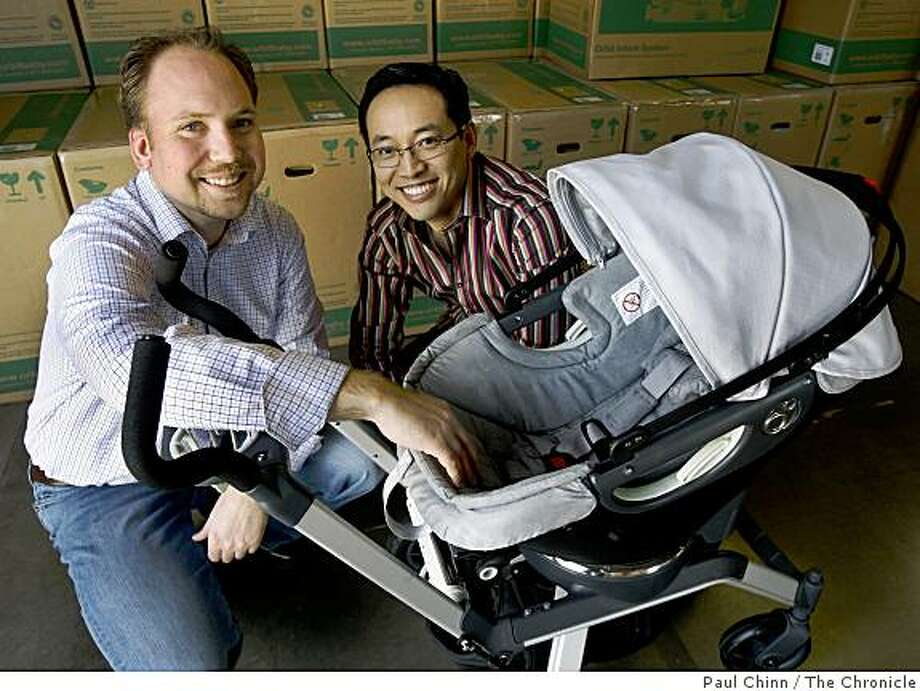 Bryan White (left), and Joseph Hei, display their popular Orbit Baby stroller, which they designed, in Newark, Calif., on Friday, March 20, 2009. Mounted on a ratchet-style ring, the bassinet can quickly be inserted on a car seat cradle. Photo: Paul Chinn, The Chronicle