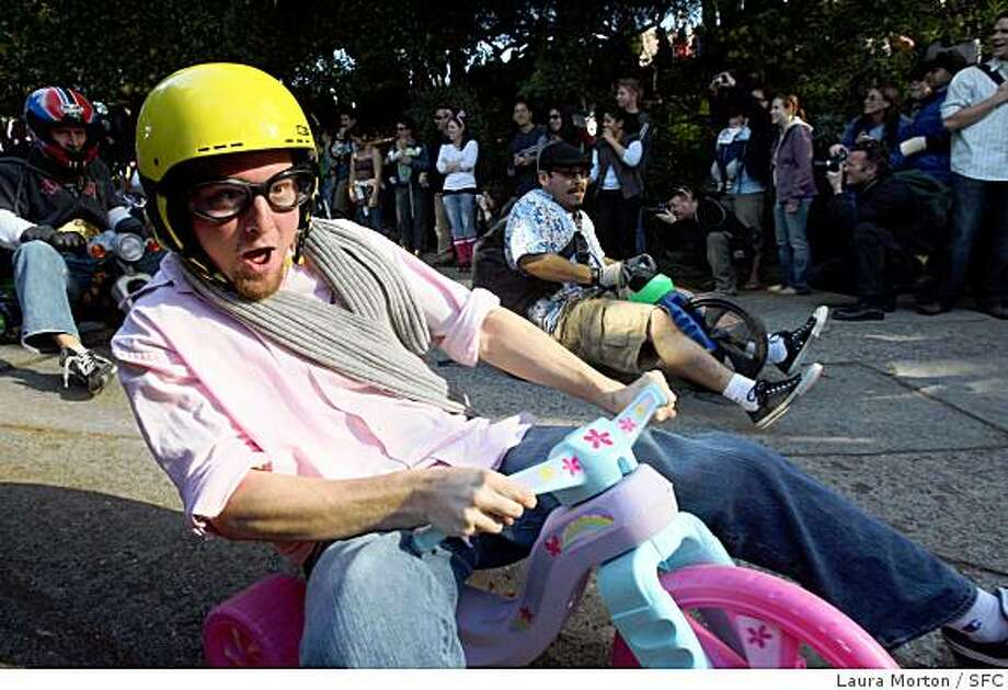 Participants in the 8th Annual Bring Your Own Big Wheel Race make their way down Vermont St. in the Potrero Hill neighborhood of San Francsico, Calif., on Sunday, March 23, 2008.  The annual event, which takes place on Easter Sunday, was moved this year from it's former location on Lombard St.     Photo by Laura Morton / Special to The Chronicle Photo: Laura Morton, SFC