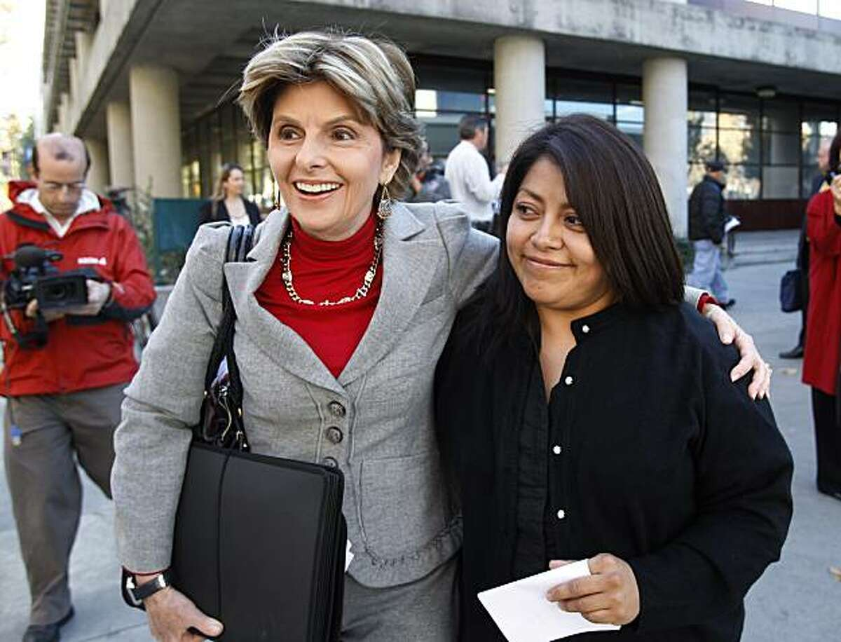 Nicky Diaz Santillan, right, and her attorney Gloria Allred, left, smile as they leave a hearing in San Jose, Calif., Wednesday, Nov. 17, 2010. Diaz Santillan, the illegal immigrant housekeeper who helped derail Meg Whitman's gubernatorial campaign, tookher case before the California Department of Industrial Relations. She claims the former eBay CEO and billionaire owes her $6,210 in unpaid wages and mileage reimbursements accrued during the nine years she spent as the Whitman family's housekeeper.