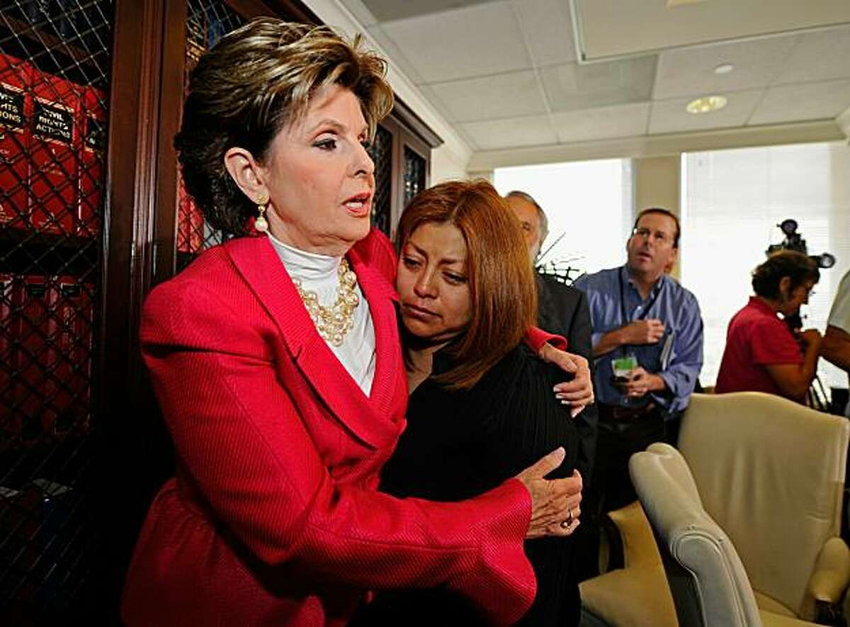 LOS ANGELES, CA - SEPTEMBER 29: Celebrity attorney Gloria Allred (L) consoles her client, California Republican gubernatorial candidate Meg Whitman's former housekeeper Nicky Diaz Santillan as they attend a press conference at Allred's offices on September 29, 2010 in Los Angeles, California. In the news conference Allred claims that Whitman knowingly employed an undocumented worker, Santillan, as her housekeeper for nine years and then fired her a few months after Whitman began her campaign for governor. Allred said she will file a claim for unpaid wages and mileage reimbursement. (Photo by Kevork Djansezian/Getty Images) *** BESTPIX ***