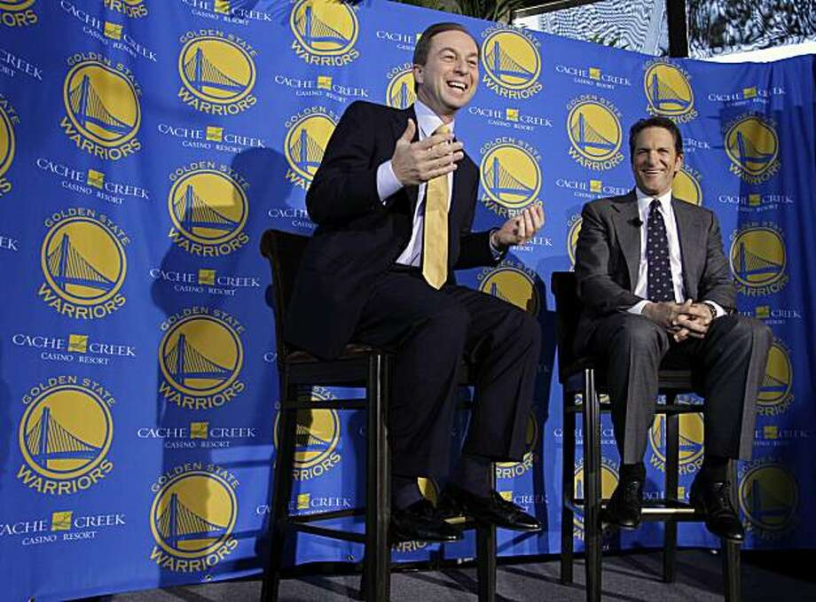 The Warriors' new owners, Joe Lacob, left, and Peter Guber, laugh during their introduction at a luncheon in San Francisco on Monday. Photo: Eric Risberg, AP