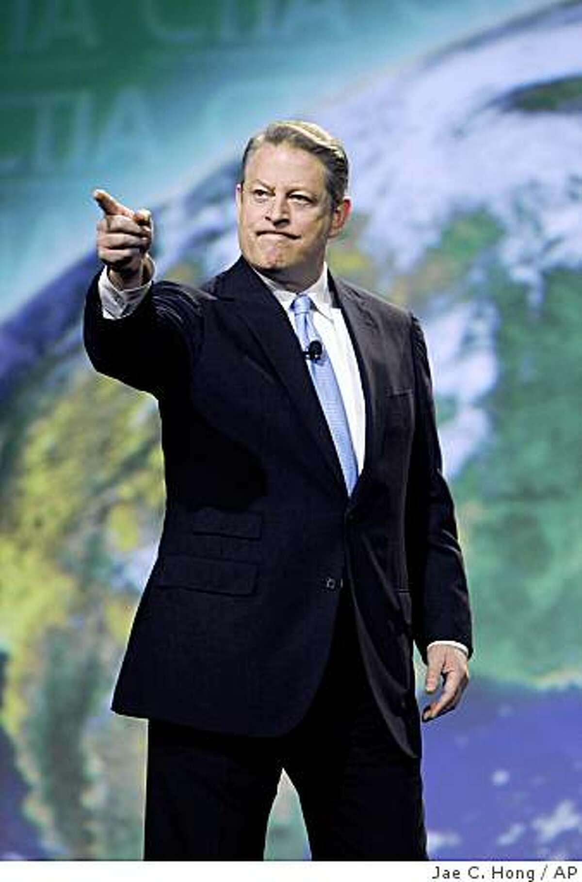 """Former Vice President Al Gore speaks at the International CTIA Wireless show in Las Vegas, Friday, April 3, 2009. Gore says government investment in green infrastructure projects, including creation of a """"smart,"""" energy efficient electricity grid, will create jobs and help address the threat of climate change. (AP Photo/Jae C. Hong)"""