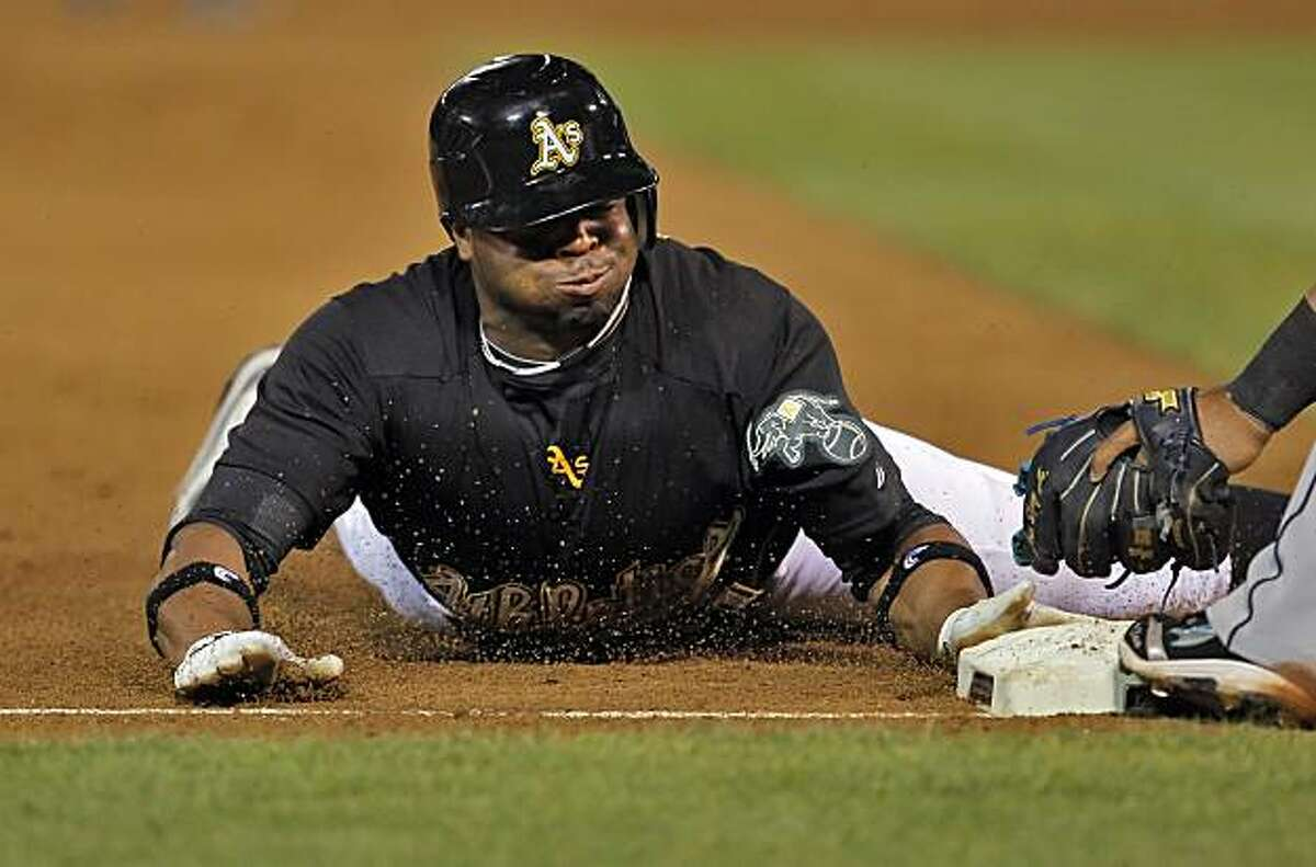 Rajai Davis steals third in the sixth inning. Davis later scored on a hit by Cliff Pennington that tied the game. The Oakland Athletics played the Seattle Mariners at the Oakland-Alameda County Coliseum in Oakland, Calif., on Wednesday, September 8, 2010.