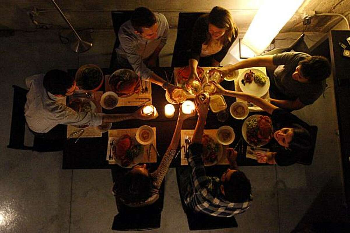 Sophie Brickman and her boyfriend Dave Eisenberg share a thanksgiving dinner with friends in San Francisco, Calif., on Nov. 06, 2010.