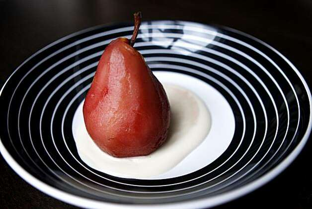 Poached pear prepared by Sophie Brickman with the assistance of her boyfriend Dave Eisenberg in San Francisco, Calif., on Nov. 06, 2010. Photo: Michelle Gachet, The Chronicle