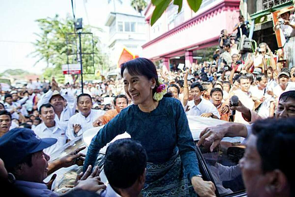 YANGON, BURMA - NOVEMBER 14: Aung San Suu Kyi arrives at her National League for Democracy (NLD) headquarters on November 14, 2010 in Yangon, Burma. Myanmar's pro-democracy leader Aung San Suu Kyi had been held under house arrest for the majority of thepast 15 years but has now finally been released by the country's military leaders. After the first elections in 20 years the military backed Union Solidarity and Development Party (USDP) is reported to have won the election.