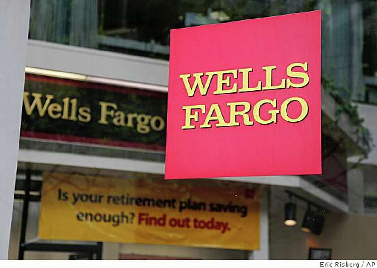 A branch of Wells Fargo bank is shown in San Francisco, Thursday, April 9, 2009. Wells Fargo & Co. said Thursday it expects record first-quarter earnings of $3 billion, easily surpassing analysts' estimates and providing an encouraging sign for the banking industry. (AP Photo/Eric Risberg)