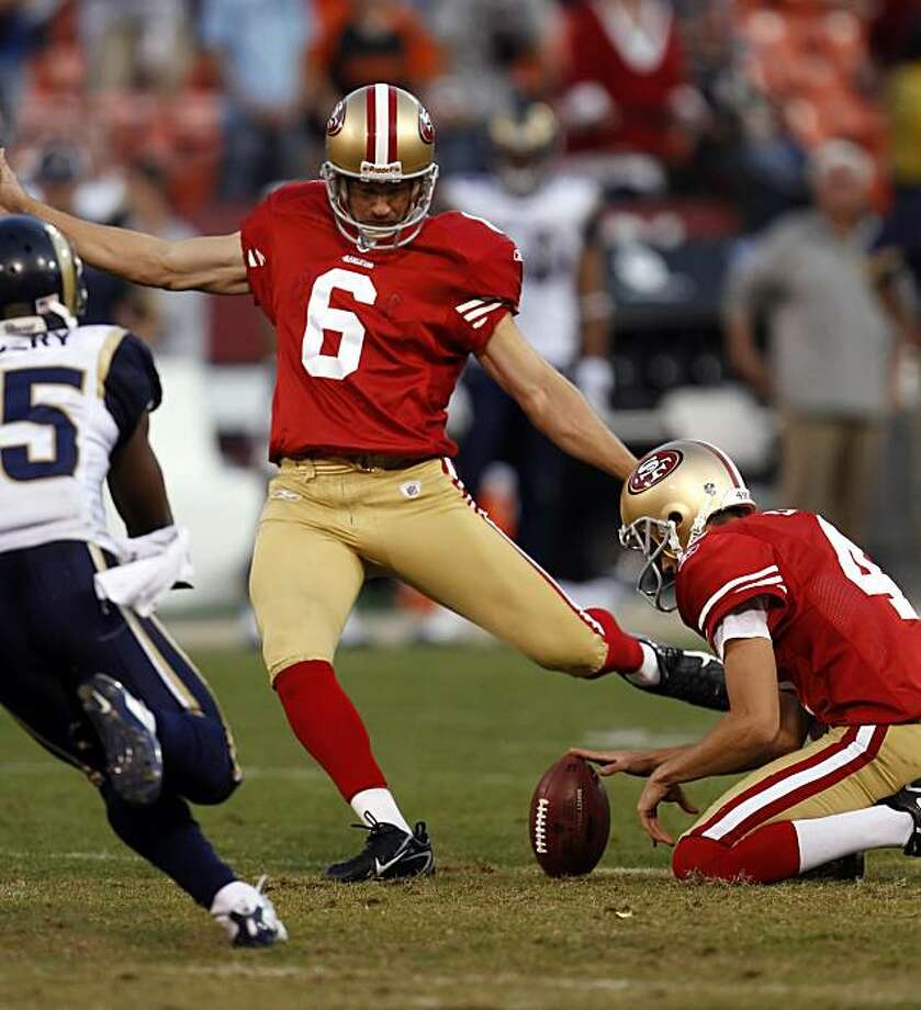 Joe Nedney kicks a field goal in overtime to give the 49ers a 23-20 win over the Rams at Candlestick Park in San Francisco on Sunday. Photo: Carlos Avila Gonzalez, The Chronicle