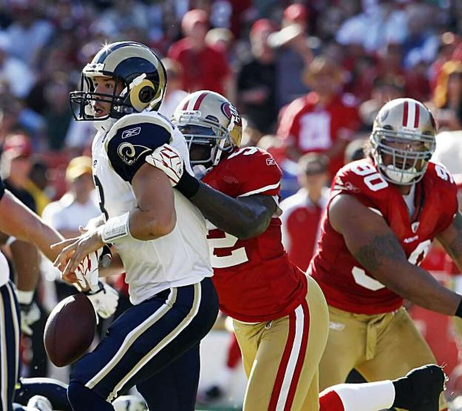 Sam Bradford is sacked by Patrick Willis, who forced a fumble in the first quarter at Candlestick Park in San Francisco on Sunday. The ball was recovered by the Rams. Photo: Carlos Avila Gonzalez, The Chronicle