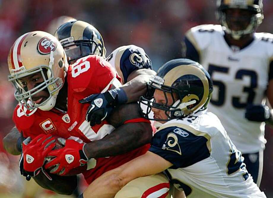 Vernon Davis is pushed out of bounds after a 32-yard catch in the first quarter against the Rams at Candlestick Park in San Francisco on Sunday. Photo: Carlos Avila Gonzalez, The Chronicle