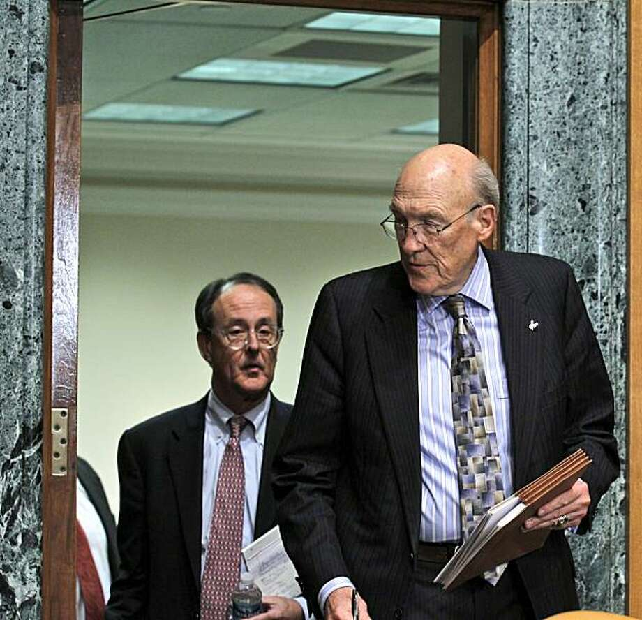 Erskine Bowles, left, follows former Wyoming Sen. Alan Simpson, on Capitol Hill in Washington Wednesday, Nov. 10, 2010, as the co-chairmen of President Barack Obama's bipartisan deficit commission arrived for a news conference. Photo: Alex Brandon, AP