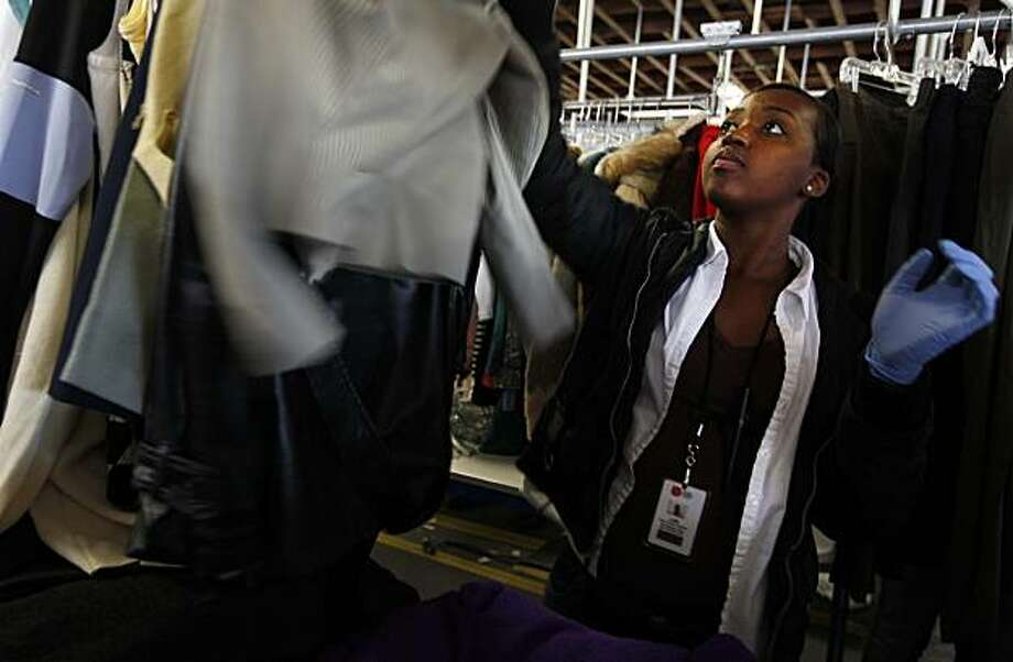 Lori Goss, who was hired in October 2010 at the Salvation Army Adult Rehabilitation Center as an employee, hangs clothes on hangers to be proceeded further to be priced and later on offered for sale at the Salvation Army thrift store, Wednesday, Nov. 3, 2010 in San Francisco, Calif. Photo: Jana Asenbrennerova, Special To The Chronicle