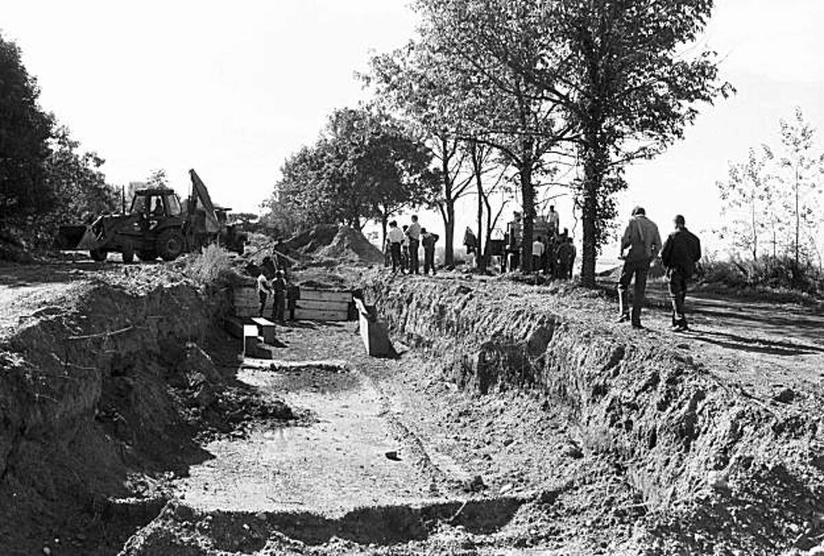 This Sept. 13, 1990 photo provided by Claire Yaffa shows a mass burial trench for adults on New York's Hart Island. Since 1869, more than 800,000 people have been laid to rest at the potter's field on the island that lies in the waters just off the Bronx borough of New York City. (AP Photo/Claire Yaffa) NO SALES